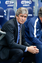 Manager Manuel Pellegrini of Manchester City looks on before kick off - Photo mandatory by-line: Rogan Thomson/JMP - 07966 386802 - 30/08/2014 - SPORT - FOOTBALL - Manchester, England - Etihad Stadium - Manchester City v Stoke City - Barclays Premier League.