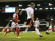 Michael Turner clearing ball from pressure from Matt Derbyshire during the Sky Bet Championship match between Fulham and Rotherham United at Craven Cottage, London, England on 15 April 2015. Photo by Matthew Redman.