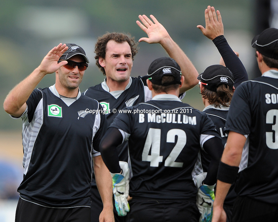Andrew Ellis and Kyle Mills celebrate after Brendon McCullum takes a catch to dismiss Zimbabwe captain Brendan Taylor during the 2nd ODI cricket match between New Zealand and Zimbabwe at Cobham Oval in Whangarei, Monday 6 February 2012. Napier, New Zealand. Photo: Andrew Cornaga/Photosport.co.nz