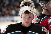 KELOWNA, CANADA - DECEMBER 6: Jordon Cooke #30 of the Kelowna Rockets stands at the bench against the Everett Silvertips on December 6, 2013 at Prospera Place in Kelowna, British Columbia, Canada.   (Photo by Marissa Baecker/Shoot the Breeze)  ***  Local Caption  ***