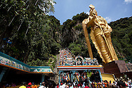 Climbing the 272 steps up to Batu Caves  for Thaipusam Festival, Batu Caves, Malaysia. It is a Hindu festival celebrated mostly by the Tamil community on the full moon in the Tamil month of Thai (Jan/Feb). The festival celebrates the birth of Murugan,the youngest son of Shiva and his wife Parvati. The festival at Batu Caves, Kuala Lumpur culminates in a 272 step climb into the cave.