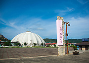 KUMGANG<br /> THE NORTH KOREAN GHOST TOWN<br /> <br /> The first town USA will find on his way to invade NK will be this ghost town where HUnday lost 1 billion USD..<br /> <br /> The Mount Kumgang tourist complex in North Korea, near the DMZ, was built in 1998 by the South Korean giant company Hyundai. The chaebol paid a fee of $1 billion to the North Korean government for 50 years of exclusivity. The cost of the 500-square kilometer complex was $400 million, including hotels, a spa, a fire station, a tourism office, a golf course, a supermarket, a clinic, tours in the mountain... Kumgang resort attracted nearly 2 millions south korean tourists from1998 to 2008.<br /> In July 2008 a South Korean tourist, Miss Park Wang-ja, was shot dead there and South Korea decided to stop all the tours in North Korea. The North Korean government said the tourist entered the military zone, and ignored the warnings from the north korean soldiers.<br /> So in retaliation, North Korea decided to seize the whole tourist complex. This decision was a real drama. Not for the touristic industry only, but for the separated families from the south and the north: Kumgang was also the place where hundreds of North and South Korean relatives were meeting each other for the first time in decades.<br /> For those reasons, since 2008, Mount Kumgang complex has became a ghost town. Only very few western tourists could visit the area.<br /> <br /> Photo shows:   My bus arrives in the complex. First it looks like an giant empty parking of a supermarket. There is nobody around, not even a soldier.<br /> ©Eric Lafforgue/Exclusivepix Media