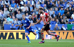 Charlie Austin of Southampton tries to chip Kasper Schmeichel of Leicester City to score a goal - Mandatory by-line: Robbie Stephenson/JMP - 02/10/2016 - FOOTBALL - King Power Stadium - Leicester, England - Leicester City v Southampton - Premier League