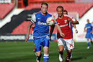 Leyton Orients Nathan Clarke (l) is challenged by Swindon's Paul Benson. NPower league one, Swindon Town v Leyton Orient at the County Ground in Swindon on Saturday 8th Sept 2012.  pic by  Andrew Orchard, Andrew Orchard sports photography,
