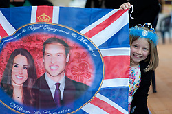 Plymouth, UK  29/04/2011. The Royal Wedding of HRH Prince William to Kate Middleton. A young girl with a Kate and William flag watches the wedding start in Plymouth. Photo credit should read London News Pictures. Please see special instructions. © under license to London News Pictures