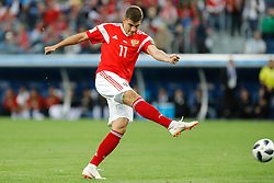 June 19, 2018 - Saint Petersburg, Russia - Roman Zobnin of Russia national team shoots on goal during the 2018 FIFA World Cup Russia group A match between Russia and Egypt on June 19, 2018 at Saint Petersburg Stadium in Saint Petersburg, Russia. (Credit Image: © Mike Kireev/NurPhoto via ZUMA Press)