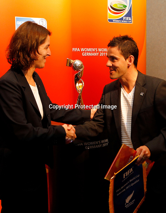 FIFA Head Of Women's Competitions Tatjana Haenni presents New Zealand Football's Women's Head Coach John Herdman with gifts. Women's Football Conference, Crowne Plaza Hotel, Auckland, Friday 10th December 2010. Photo: Shane Wenzlick