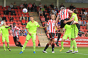 Aaron Downes scores the opening goal in the 2nd half during the Vanarama National League match between Cheltenham Town and Southport at Whaddon Road, Cheltenham, England on 15 August 2015. Photo by Antony Thompson.