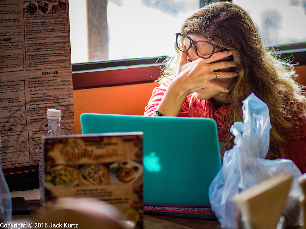09 NOVEMBER 2016 - BANGKOK, THAILAND:  A woman watching US election results in Bangkok reacts to news that Donald J. Trump had taken the lead in the Electoral College vote. Democrats Abroad Thailand met at the Roadhouse Barbecue, an American restaurant in Bangkok, to watch election results come in. It was a somber election watch party as what was expected to be a Clinton victory turned into a Trump win.     PHOTO BY JACK KURTZ