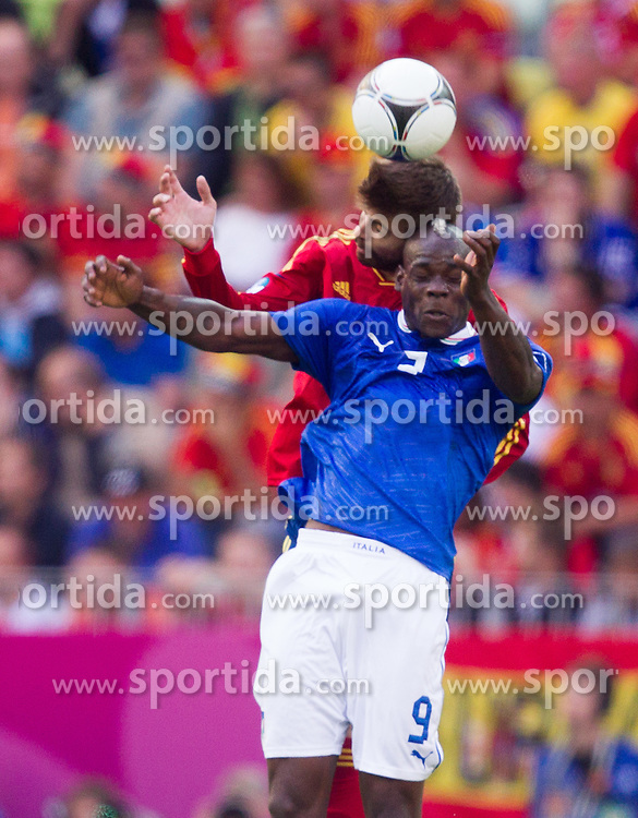 Gerard Pique of Spain vs Mario Balotelli of Italy during the UEFA EURO 2012 group C match between Spain and Italy at The Arena Gdansk on June 10, 2012 in Gdansk, Poland.  (Photo by Vid Ponikvar / Sportida.com)