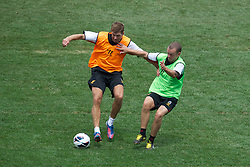 BALTIMORE, MD - Friday, July 27, 2012: Liverpool's captain Steven Gerrard and Jay Spearing during a training session ahead of the pre-season friendly match against Tottenham Hotspur at the M&T Bank Stadium. (Pic by David Rawcliffe/Propaganda)