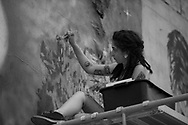 Ramajana Nadarevic works on her mural late in the evening of August 5, 2017 during the Freak Alley Gallery seventh annual mural event in downtown Boise, Idaho.<br /> <br /> Freak Alley Gallery's week long event provided an &quot;art-in-motion&quot; experience as it welcomed the public to watch artists work on their murals.
