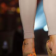 NLD/Amsterdam/20121117 - Danny de Munk 30 jaar in het vak, tattoo op de enkels van Roxeanne Hazes