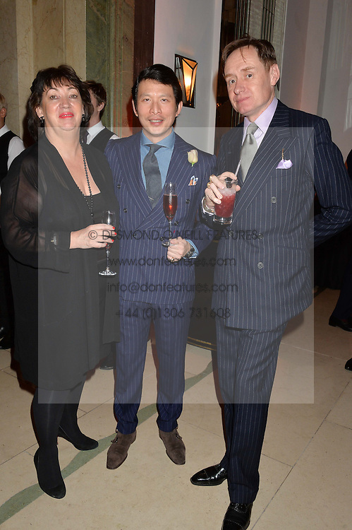 Left to right, PAULA FITZHERBERT, WEI KOH and NICK FOULKES at a reception hosted by The Rake Magazine and Claridge's to celebrate London Collections 2015 held at Claridge's, Brook Street, London on 8th January 2015.