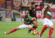 Benfica's player Salvio (L ) fights for the ball with Maritimo´s player China   (R ) during Portuguese First League football match C.S. Maritimo vs S.L. Benfica held at Barreiros Stadium, Funchal, Portugal, 01 December, 2016.