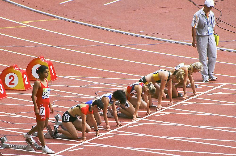 Paralympics Day 3 - Beijing 2008<br /> Women's 100m T38 Round 1 heat 1<br /> Athletes are preparing to start in the Women's 100m T38 round 1 Heat 1 of the Paralympic Games 2008. From right : lane 1 KIRUSHCHANKA Katsiaryna (Blr), PARRISH Katy (Aus), KOPTILOVA Margarita (Rus), MICHOU Aikaterini (Gre), SLABY Tamira (Ger) and MANSOUR Sonia (Tun) standing. September 9 2008.