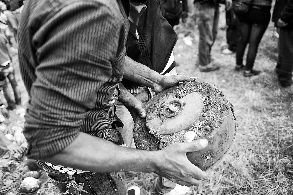 A protester moves a land mine out of the protest area. The Lebanese army stated that 10 protesters died due to gunshot wounds by the Israeli army and 112 were wounded.Tens of thousands of Palestinians and their supporters gathered at the border town of Maroun Al Rass to commemorate 63 years since the Nakba or catastrophe. Palestinians commemorate on May 15 the loss of their homeland.  Maroun Al Rass, Lebanon, May 15, 2011. OMAR YASHRUTI/PI, PRENSA-INTERNACIONAL.COM
