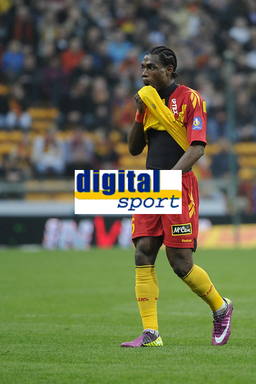 FOOTBALL - FRENCH CHAMPIONSHIP 2010/2011 - RC LENS v STADE BRESTOIS 29 - 16/04/2011 - PHOTO : ALAIN GADOFFRE / DPPI - DECEPTION HENRI BEDIMO (RCL)
