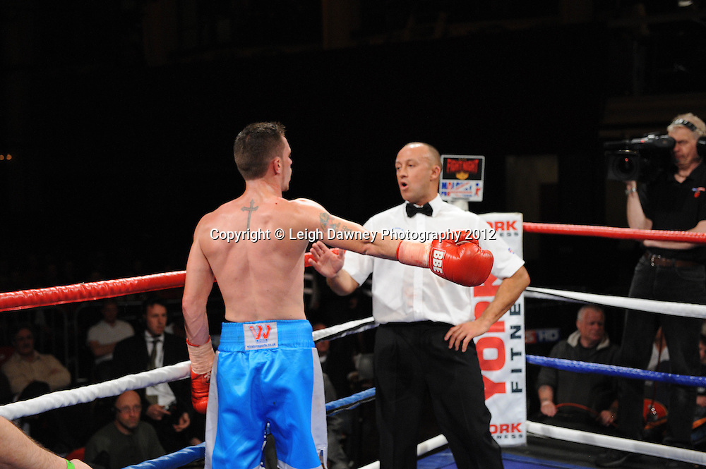 Martin Walsh arguing with the referee's decision after he is disqualified and Rick Godding claims the Welterweight contest at The Winter Gardens, Blackpool on the 31st March 2012. Frank Maloney and Steve Wood VIP Promotions. © Leigh Dawney Photography 2012.