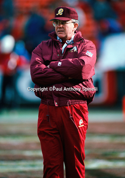 Washington Redskins head coach Joe Gibbs watches pregame warmups before the NFL NFC divisional playoff football game against the San Francisco 49ers on Jan. 9, 1993 in San Francisco. The 49ers won the game 20-13. (©Paul Anthony Spinelli)
