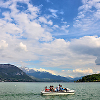Paddle Boat in Lake Annecy in Annecy, France <br /> Lake Annecy is gorgeous …. period.  It is over nine miles long, making it France's third largest lake. It is also the country's cleanest. The section seen from the Promenade Jacquet is called the Grand Lac. It was created by a melting glacier thousands of years ago which is why it reaches a maximum depth of almost 270 feet. It is fed from several rivers flowing down the surrounding mountains named Dents de Lanfon, Lanfonnet and La Tournette.