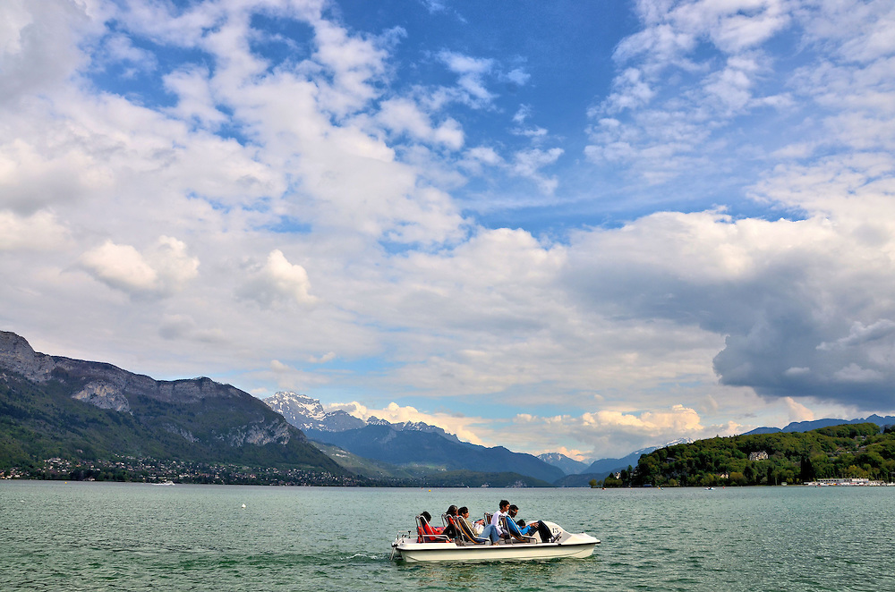 Paddle Boat in Lake Annecy in Annecy, France <br /> Lake Annecy is gorgeous &hellip;. period.  It is over nine miles long, making it France&rsquo;s third largest lake. It is also the country&rsquo;s cleanest. The section seen from the Promenade Jacquet is called the Grand Lac. It was created by a melting glacier thousands of years ago which is why it reaches a maximum depth of almost 270 feet. It is fed from several rivers flowing down the surrounding mountains named Dents de Lanfon, Lanfonnet and La Tournette.