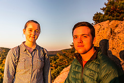 "Emily Peterson and Connor Huggins on ""The Beehive"" in fall in Maine's Acadia National Park."