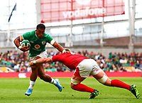 Rugby Union - 2019 pre-Rugby World Cup warm-up (Guinness Summer Series) - Ireland vs. Wales<br /> <br /> Bundee Aki (Ireland) in action against Aaron Wainwright (Wales) at The Aviva Stadium.<br /> <br /> COLORSPORT/KEN SUTTON