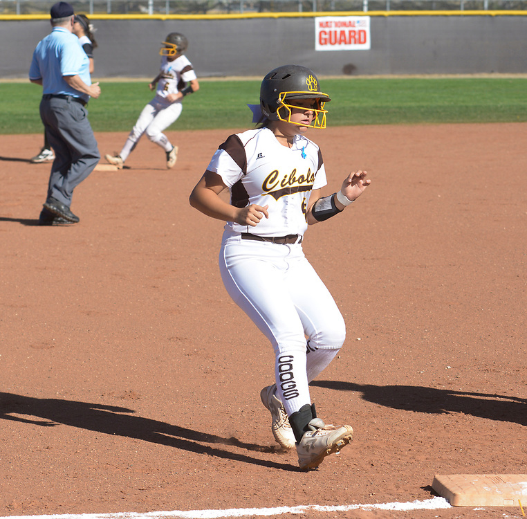 gbs040617y/SPORTS -- Cibola's Sydney Muniz reaches third as Sumar Black gets on second base in the first inning of the game against Volcano Vista on Thursday, April 6, 2017. (Greg Sorber/Albuquerque Journal)