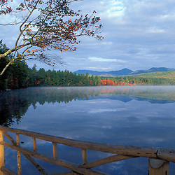 Fall reflections in Chocorua Lake in New Hampshire's White Mountains.  Chocorua, NH
