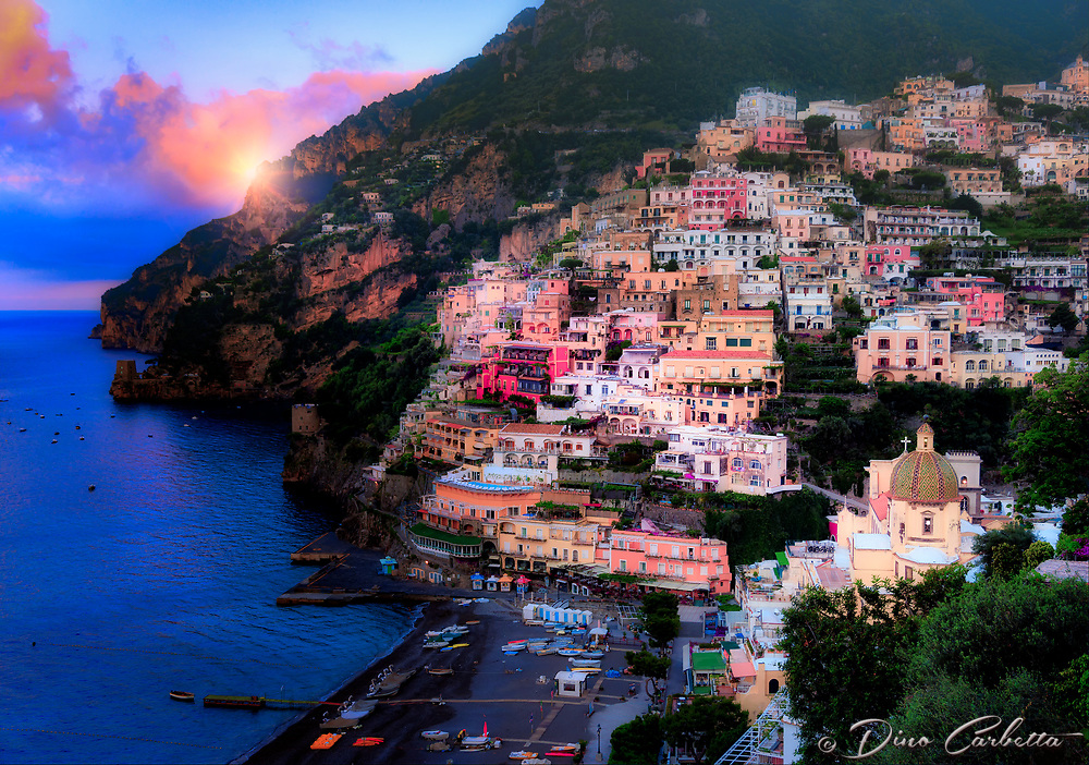 """Sunrise breaking through the clouds over peaceful Positano""…<br />