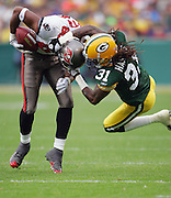 GREEN BAY, WI - SEPTEMBER 25:  Cornerback Al Harris #31 of the Green Bay Packers head tackles wide receiver Michael Clayton #80 of the Tampa Bay Buccaneers after a pass reception at Lambeau Field on September 25, 2005 in Green Bay, Wisconsin. The Buccaneers defeated the Packers 17-16. ©Paul Anthony Spinelli *** Local Caption *** Al Harris;Michael Clayton