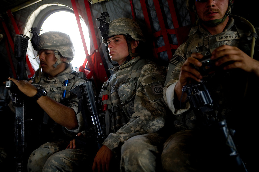 Sargeant Doolittle, center, of the 82nd Airborne's 1/508 Alpha Company and his squad ride a Chinook back to Forward Operation Base Diablo after a mission in remote Kandahar province, Afghanistan on Wednesday, March 28, 2007.