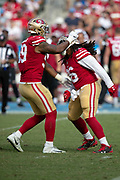 San Francisco 49ers defensive tackle Sheldon Day (96) gets a pat on the helmet from San Francisco 49ers defensive tackle DeForest Buckner (99) as Day dances and celebrates after sacking the quarterback for a loss of 10 yards and forcing a third quarter punt during the NFL week 4 regular season football game against the Los Angeles Chargers on Sunday, Sept. 30, 2018 in Carson, Calif. The Chargers won the game 29-27. (©Paul Anthony Spinelli)