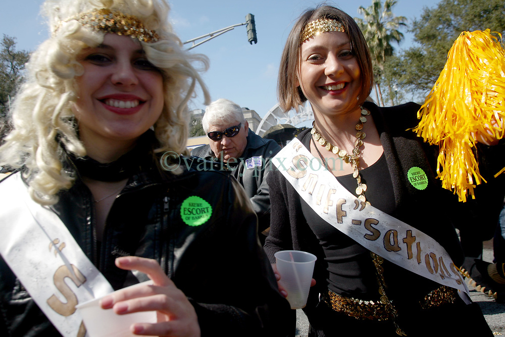07 February 2010. New Orleans, Louisiana, USA. <br /> L/R Stacey Ramey and Sarah Roberts. The 'Barkus' parade sets off with Saints mania clearly the flavour of the day for New Orleans' only dog Mardi Gras parade. Saints fans gather in the French Quarter in anticipation of the big game in Miami later in the day as the home team goes head to head with the Indianapolis Colts for Superbowl 44. <br /> Photo ©; Charlie Varley/varleypix.com