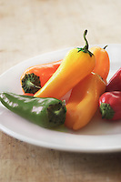 Assorted Baby peppers on white plate