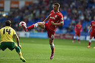Anthony Pilkington of Cardiff city in action (r). Skybet football league championship match, Cardiff city v Norwich city at the Cardiff city Stadium in Cardiff, South Wales on Saturday 13th Sept 2014<br /> pic by Andrew Orchard, Andrew Orchard sports photography.