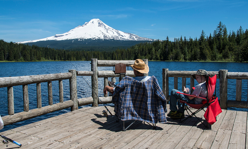 """There is a saying """"the worst fishing day is better than the best working day"""". A father and son enjoy fishing at Terillium lake near  Mt. Hood,  Hwy 26, Oregon."""