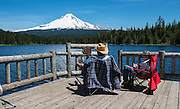 "There is a saying ""the worst fishing day is better than the best working day"". A father and son enjoy fishing at Terillium lake near  Mt. Hood,  Hwy 26, Oregon."