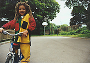 Little kid with dreads on a bike, UK, 2000's