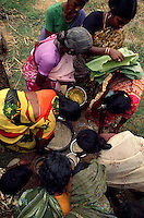 TAMIL NADU, MARCH 1994.Several women are gathering around food pots. They are usually family members who visit the 'patients'. They bring them food and try to cleanse them of the evil spirits believed to possess their bodies.