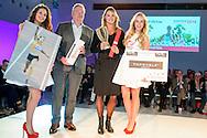 Uitreiking Sportprijs Utrecht 2014 at Jaarbeurs Utrecht: (L-R) Dafne Schippers (met beker) naast FC Utrecht eigenaar Frans van Seumeren met haar prijs van de uitverkiezing van de sportvrouw van het jaar 2014 uit Utrecht