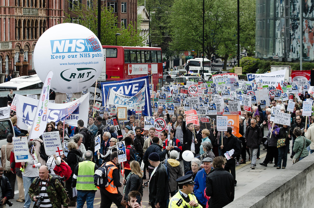 © Licensed to London News Pictures. 18/05/2013. London, UK. Protestors stop traffic as they march in central London against the Government's changes to the Health Service and planned closures to services across London.   Backed by Unite the Union, the Save Lewisham Hospital Campaign and MPs including Andy Slaughter and Steve Pound. Photo credit : Richard Isaac/LNP