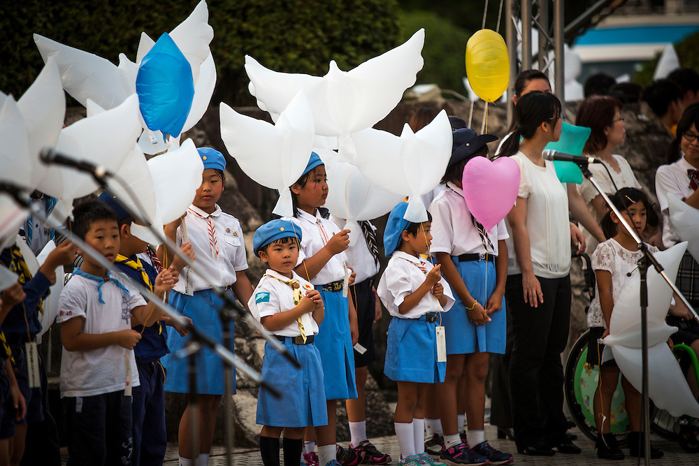 NAGASAKI, JAPAN - AUGUST 8 : Children wait to release dove and heart shaped balloons for the victims of the atomic bombing on the eve ahead of the 71st anniversary activities, commemorating the atomic bombing of Nagasaki on August 8, 2016 in Nagasaki, southern Japan. On August 9, 1945, during World War II, the United States dropped the second Atomic bomb on Nagasaki city and killing an estimated 40,000 people which ended the World War II. (Photo by Richard Atrero de Guzman/NURPhoto)
