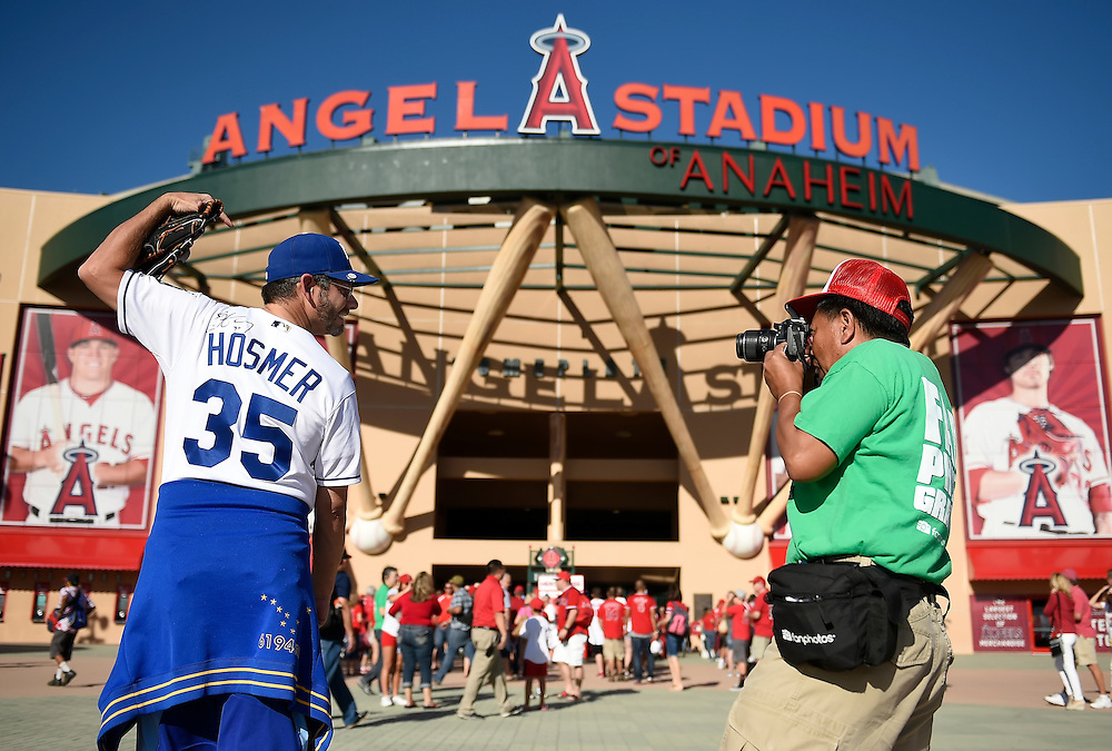 Darrell Pilant of Carlsbad, CA, left, wore his autographed Eric Hosmer All Star Game jersey and had his photograph taken by Arthur Panaligan with Angels Fan Photos prior to Thursday's ALDS baseball game on October 2, 2014 at Angels Stadium in Anaheim, Calif. Pilant used to work in Kansas City.