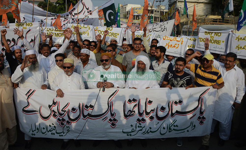 August 28, 2017 - Lahore, Punjab, Pakistan - Pakistani activists of a religious party chant slogans during an anti-U.S demonstration in Lahore. Pakistan's political, religious and military leaders have rejected President Donald Trump's allegation that Islamabad is harboring militants who battle U.S. forces in Afghanistan. (Credit Image: © Rana Sajid Hussain/Pacific Press via ZUMA Wire)