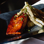 PASCO, NEW PORT RICHEY, FL--012507--Ginger Teriyaki Salmon; pan seared marinated Salmon finished in Ginger Teriyaki glaze served with Jasmine rice and tempura string beans. Zen Forrest is located at 4148 Rowan Road at S.R. 54 in New Port Richey. ??? STY, CHRIS URSO STAFF, 04 OF 05  PHOTOS