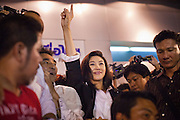 03 JULY 2011 - BANGKOK, THAILAND:    YINGLUCK SHINAWATRA, the Prime Minister elect of Thailand, greets supporters in downtown Bangkok after winning the Thai elections Sunday night. If her election holds she will be the first woman elected Prime Minister of Thailand. Yingluck Shinawatra and the Pheu Thai Party scored a massive landslide win in the Thai election Sunday. Pheu That is estimated to have won more than 300 seats in Thailand 500 seat parliament, so they won an absolute majority and could govern without having to form a coalition with minor parties. Pheu Thai is the latest incarnation of deposed former Prime Minister Thaksin Shinawatra's political party. Yingluck is his youngest sister. Many observers expect legal challenges to the Pheu Thai victory and the election does not completely resolve Thailand's difficult political history of the last five years.  PHOTO BY JACK KURTZ