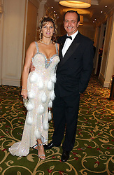 TV presenter and motoring correspondent QUENTIN WILSON and his wife MICHAELA  at the children's charity ChildLine 19th Birthday Ball held at the Grosvenor House Hotel, Park Lane, London on 29th October 2005.<br />