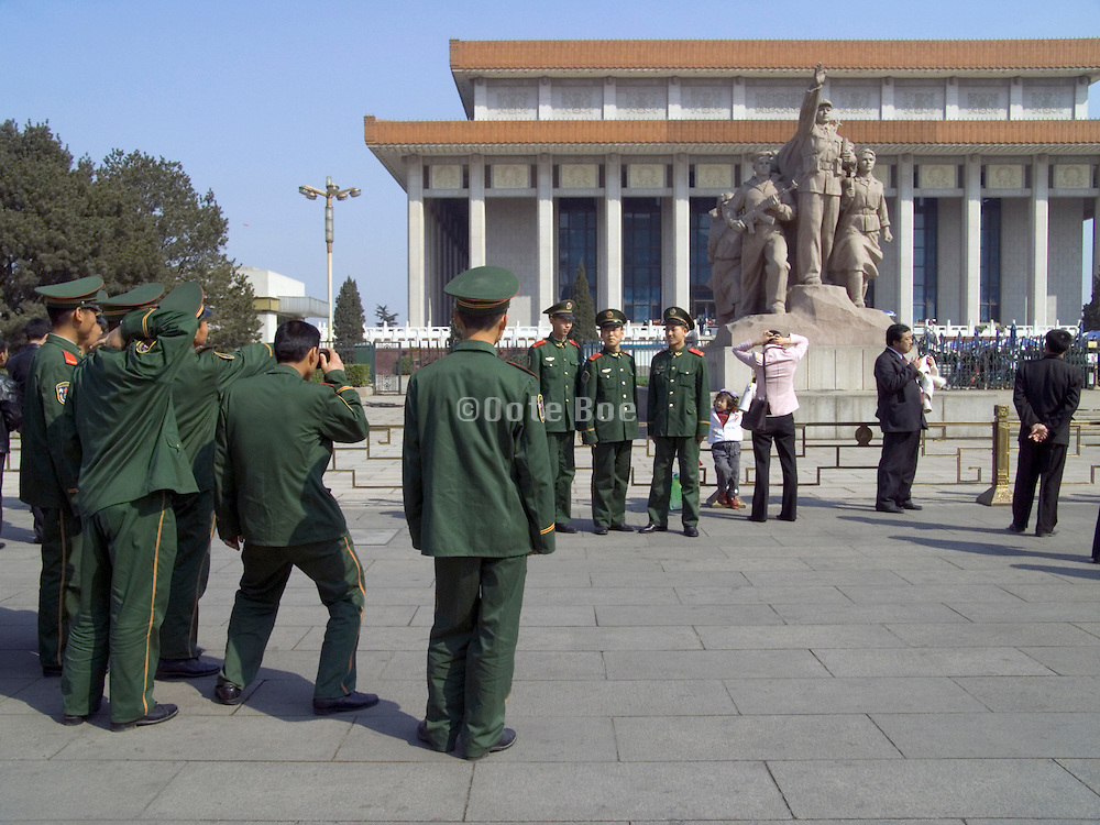 group of young cadets photographing each other in front of Mao Zedongs mausoleum Beijing